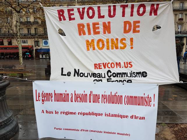 "Banners read; ""Revolution, Nothing Less"", signed by Le Nouveau Communisme en France, and ""Humanity Needs Communist Revolution – Down with the Islamic Republic Regime in Iran"", signed by the Communist Party of Iran (Marxist-Leninist-Maoist)."