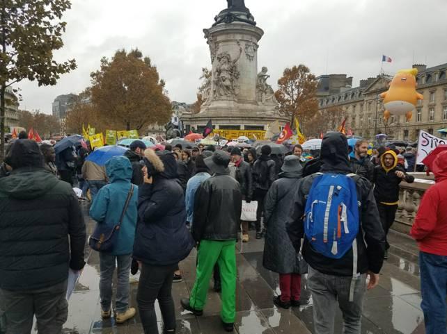 Demonstrators gather in the rain at the Place de la Republique in Paris.